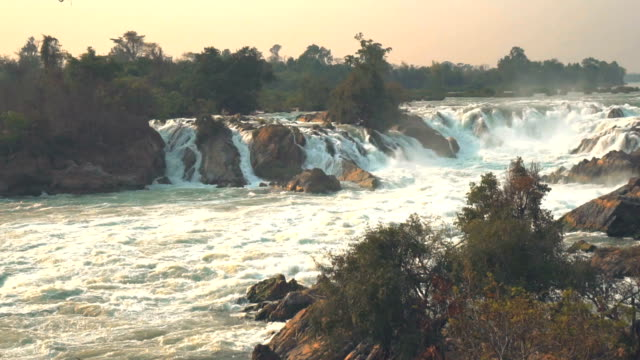 SLO MO PAN shot of a large beautiful waterfall during sunset video