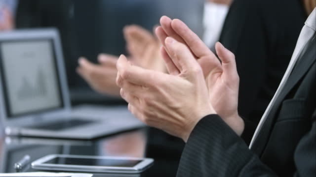 LD shot of applauding hands in business meeting Medium locked down shot of a men's hands clapping while at the meeting table. applauding stock videos & royalty-free footage