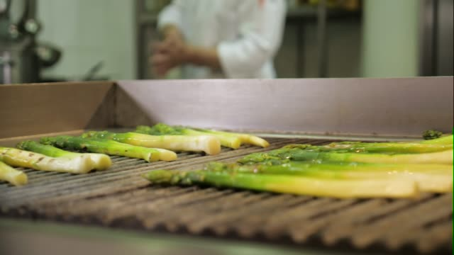 Shot of cooking green asparagus on grill pan