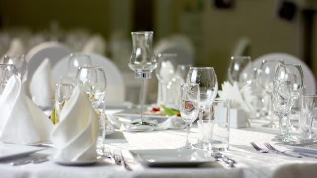 Shot of dinner table with food and waiter serving dishes at restaurant video