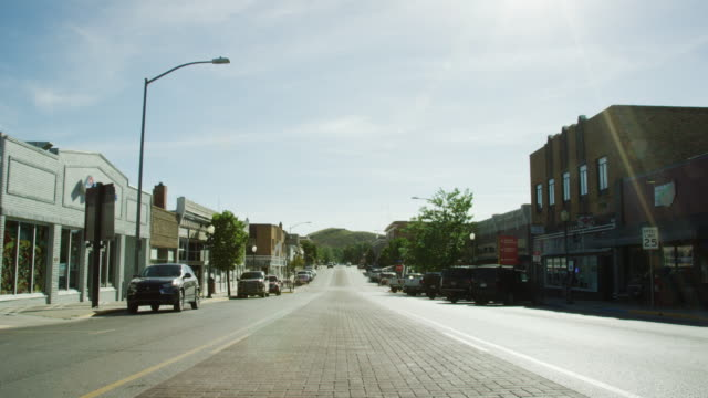 Shot of Downtown Rawlins, Wyoming from the Middle of the Street under a Sunny Sky