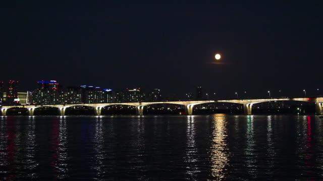 Shot of full moon shining over Han River and Wonhyo Bridge in Seoul, South Korea