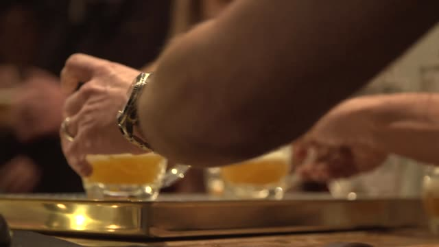 a shot of glasses of beer being passed over the bar in a pub - belgio video stock e b–roll