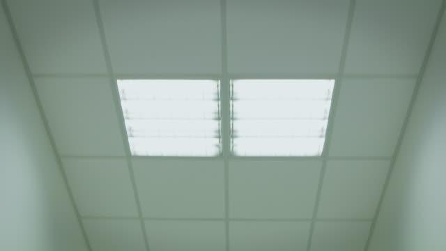POV shot of illuminated ceiling in hospital