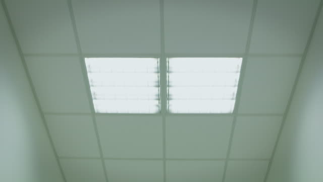 pov shot of illuminated ceiling in hospital - hospital стоковые видео и кадры b-roll