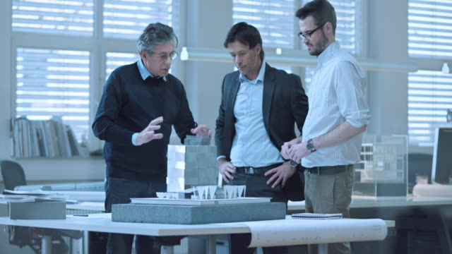 LD shot of investor discussing the design plans with architects video