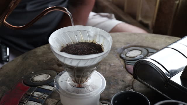 Shot of making  drip coffee with morning natural light