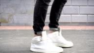 istock Shot of men legs in sneakers walking on tile road. 836238460