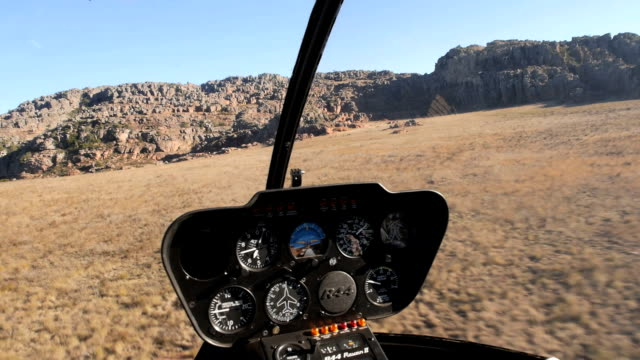 Shot of mountain top and mountain scenics from inside helicopter video