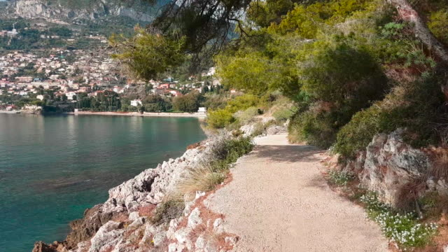 POV Shot Of Walking On The Path By The Mediterranean Sea POV Shot Of Walking On The Path By The Mediterranean Sea in Roquebrune-Cap-Martin On The Cote d'Azur, France, Europe - 4K Video provence alpes cote d'azur stock videos & royalty-free footage