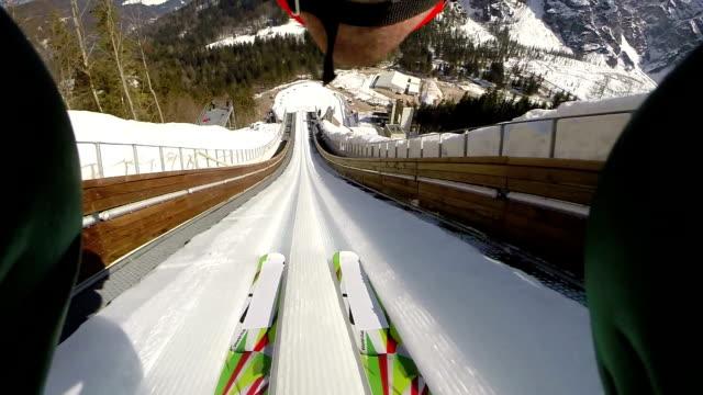 hd: shot of young man at ski jumping - vintersport bildbanksvideor och videomaterial från bakom kulisserna