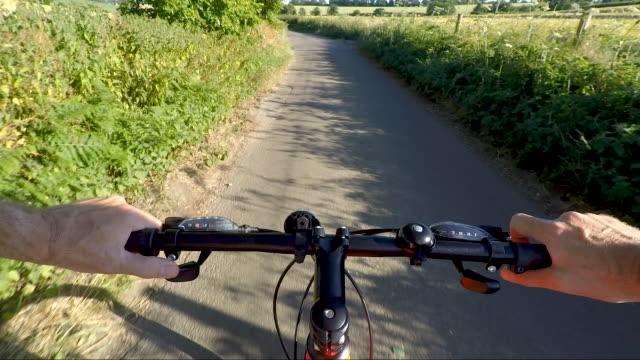 POV shot on bicycle ride along country road Action camera shot. handlebar stock videos & royalty-free footage