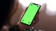 istock Shot over Shoulder Chroma key Smart Phone 1166424826
