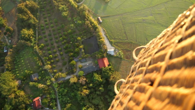 2 shots Aerial view of hot air balloon. 2 shots by LS Hand-held Camera and Tilt up camera : Aerial view of hot air balloon. hot air balloon stock videos & royalty-free footage