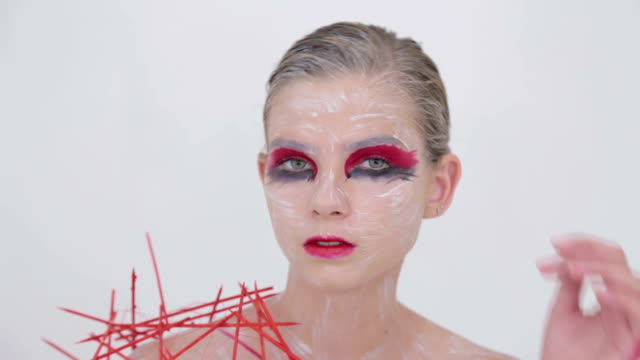 3 shots. Portrait of mysterious girl with creative make-up and elegant hairstyle video