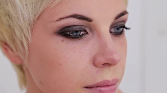 3 shots. Professional make-up artist applying makeup on the face of the beautiful young sensual model video