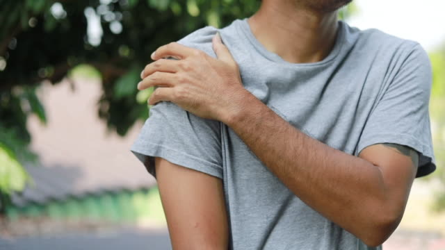 Shoulder Injuries, young man with pain in shoulder, Ache in human body , office syndrome , health care concept