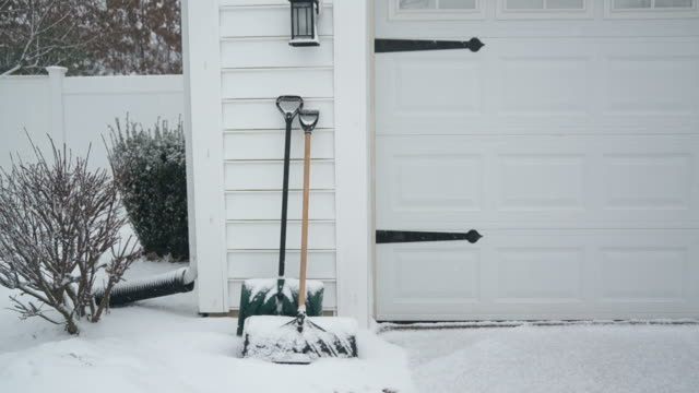 Shovels Leaning Against Garage in Snow Storm video