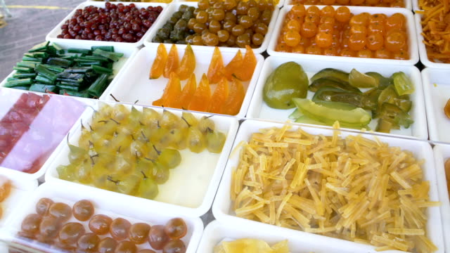 Showcase with candied fruit beckoning customers with its sweetness and colors