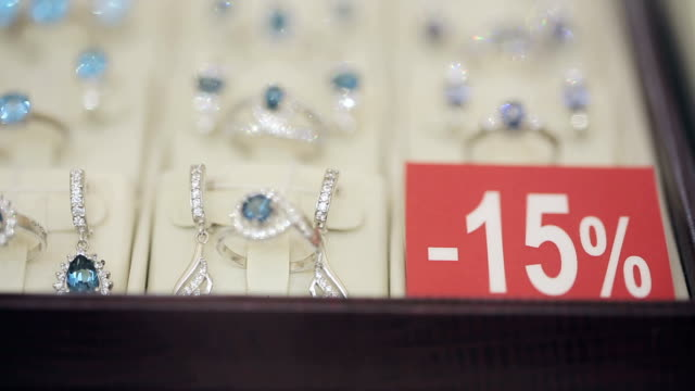 Showcase with jewelry and card with amount of discounts video