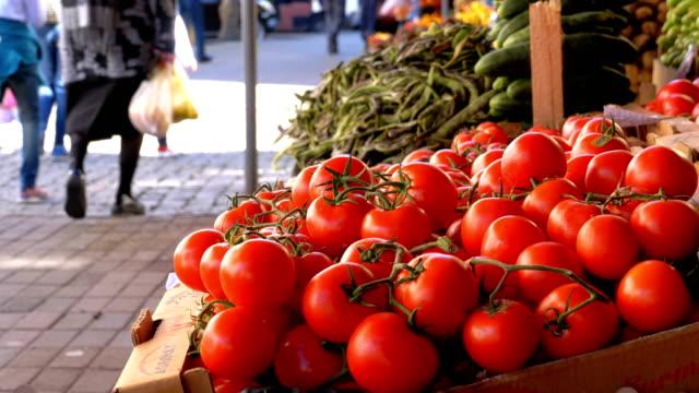 Showcase with Tomato on the Street Market