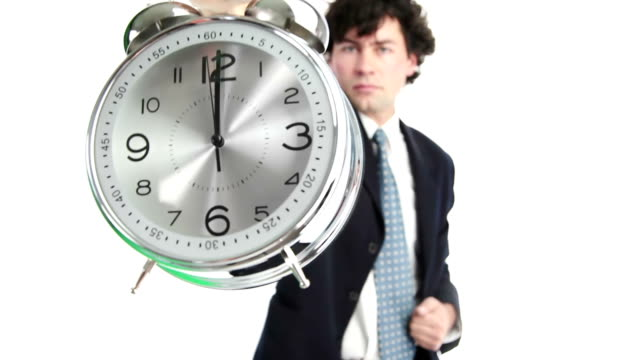 Showing Clock Businessman shows the clock. checking the time stock videos & royalty-free footage