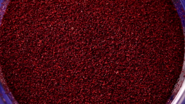 Shredded dried red pepper. Food background video