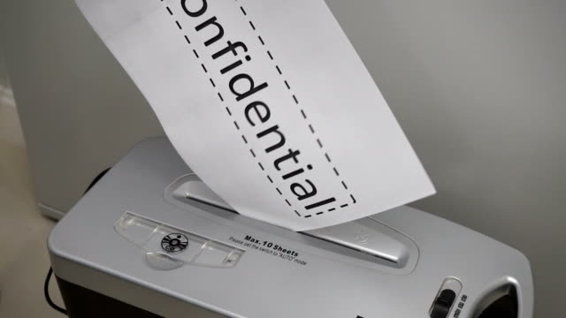 Shredding documents for security. video