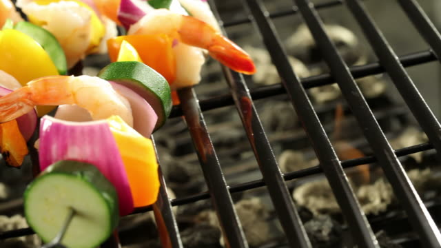 Shrimp and vegetable skewers on barbecue grill video