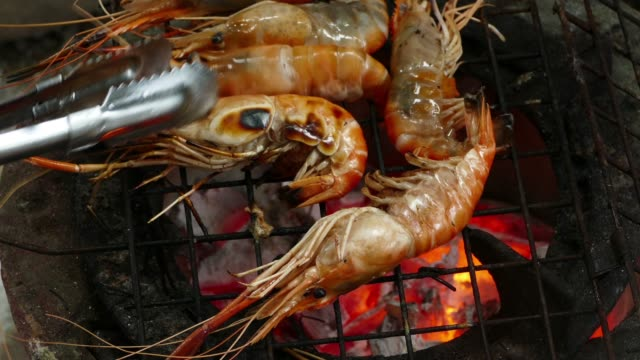 Shrimp on the grill Sea food Shrimp on the grill. 4K Apple ProRes 422 (HQ) 3840x2160 Format shrimp seafood stock videos & royalty-free footage