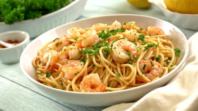Shrimp Scampi with Spaghetti Delicious shrimp scampi served over spaghetti. shrimp seafood stock videos & royalty-free footage