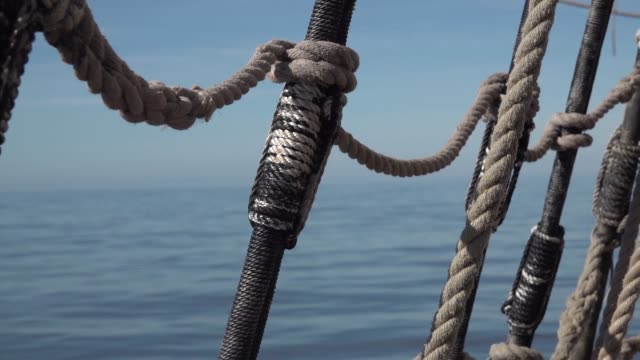 Shrouds and ropes of an old sailboat in the open sea