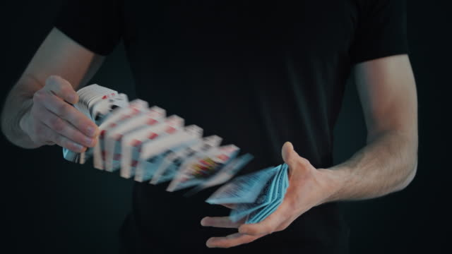 Shufflingperforming card s Magician performing card trick. Slow motion. Source: Sony RAW 4K 12bit. playing card stock videos & royalty-free footage