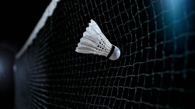 slo mo shuttlecock hitting the net - badminton stock videos & royalty-free footage