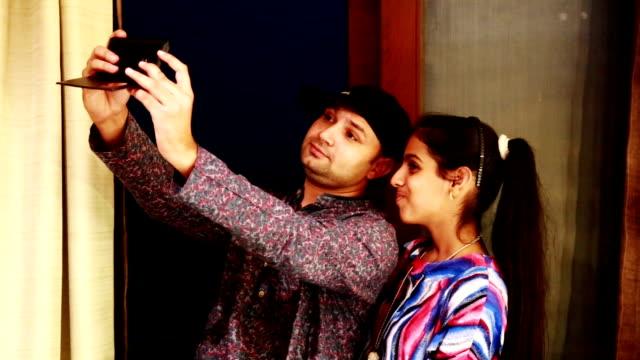 Sibling taking selfie