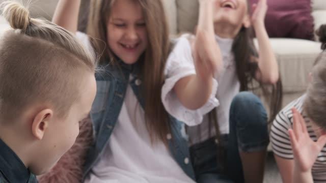 Siblings cheering and playing foosball at home video