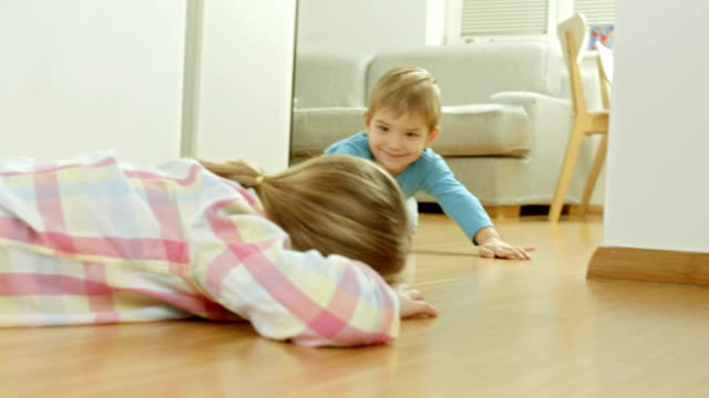 Siblings Playing At Home HD1080p: Two little siblings having fun playing on the floor at home. playroom stock videos & royalty-free footage