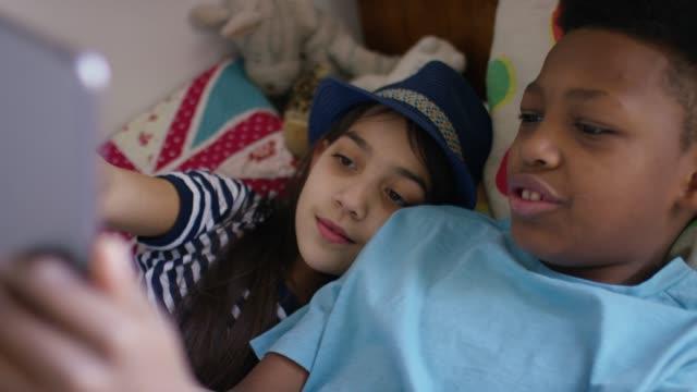 2 siblings using a digital tablet