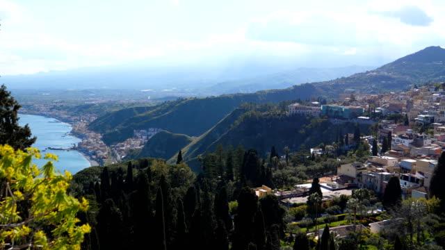 Bидео Sicilian scenery of Taormina town and cypress trees