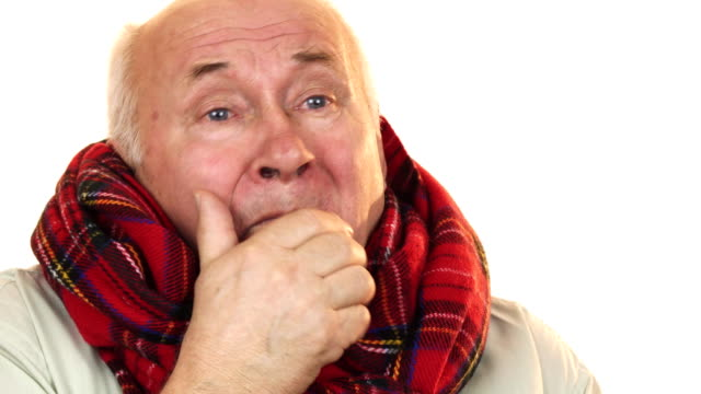 Sick and ill senior man wearing a scarf coughing looking tired video