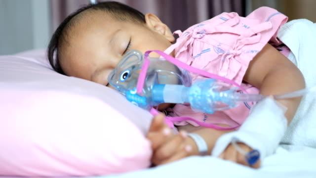Sick Asian boy sleeping and nebulizer video
