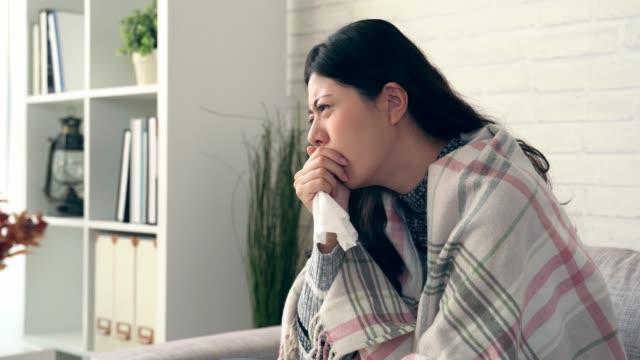 sick asian woman caught cold and flu - flu shot стоковые видео и кадры b-roll
