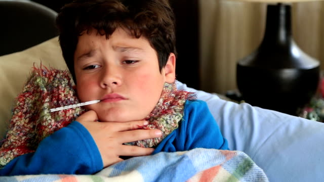 Sick child laying in bed with fever video