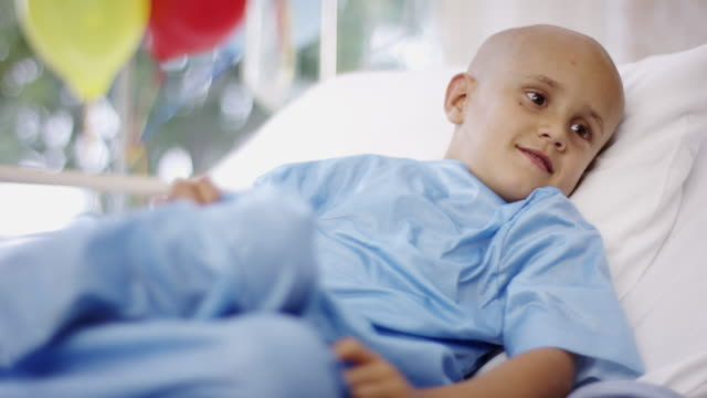 Sick little boy in hospital bed with cancer Little boy with cancer going through treatment at the hospital cancer illness stock videos & royalty-free footage