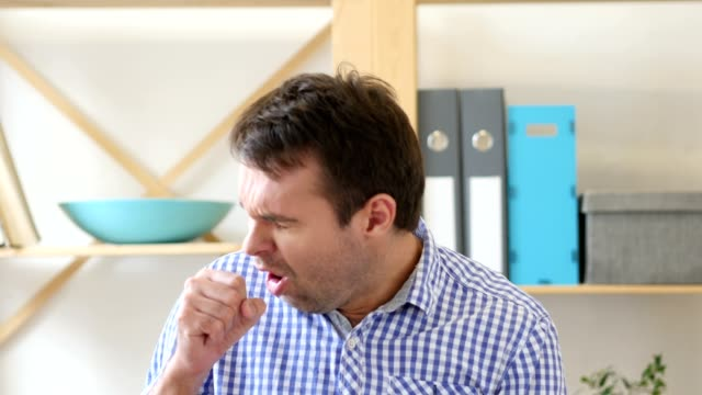 Sick Man Coughing  Sitting in Office video