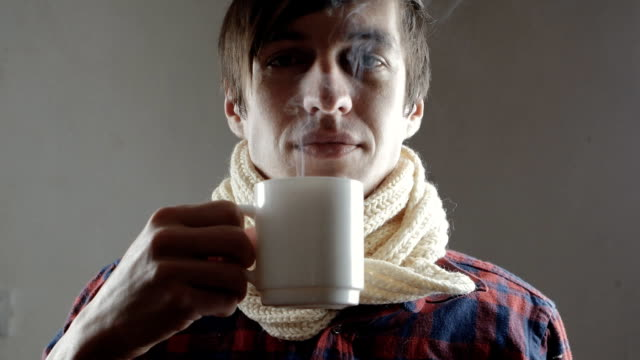 sick man drinking hot tea close up of Sick young man coughing emphysema stock videos & royalty-free footage