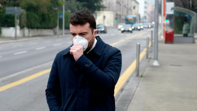 sick man in the urban traffic air pollution - face mask stock videos & royalty-free footage