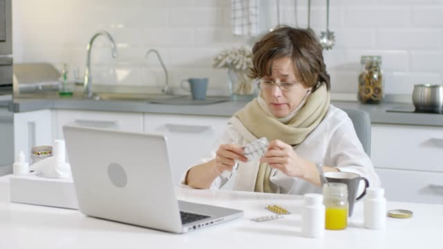 Sick Woman Having Online Medical Consultation