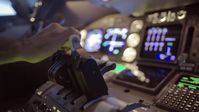 Side angle view of airline pilot's hand using throttle video