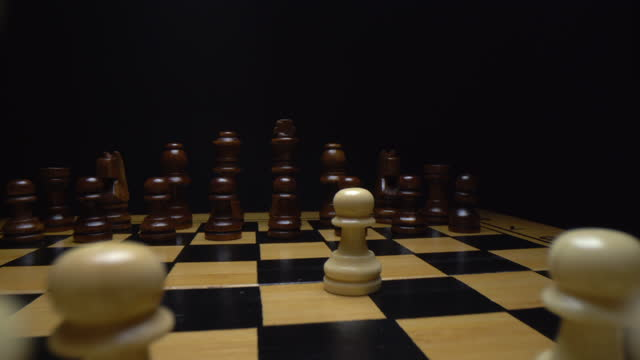 Side dolly camera movement throw the chess pieces